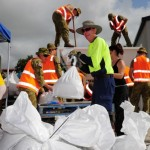 volunteers and Army Reserve soldiers from Queensland fill sandbags. Australian Department of Defence / Corporal (CPL) Janine Fabre